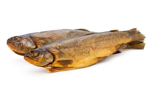 Smoked trout in front of a white background.